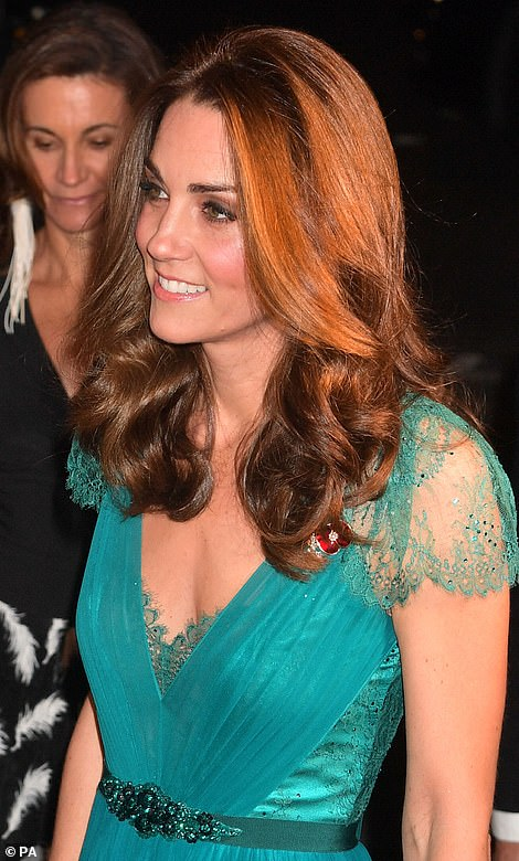 The mother-of-three took a departure from her original look, swapping her formal chignon hairstyle for loose waves for this evening's event