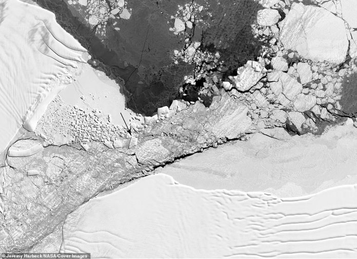 """Section of a Landsat 8 image of the """"square"""" iceberg area, with an arrow identifying the iceberg in question."""
