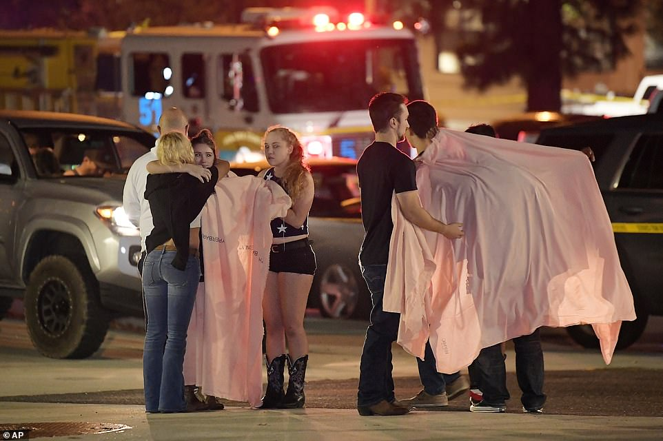 California: Witnesses and survivors comfort each other as they stand near the scene of the shooting at the at the Borderline Bar and Grill in Thousand Oaks, California, last night