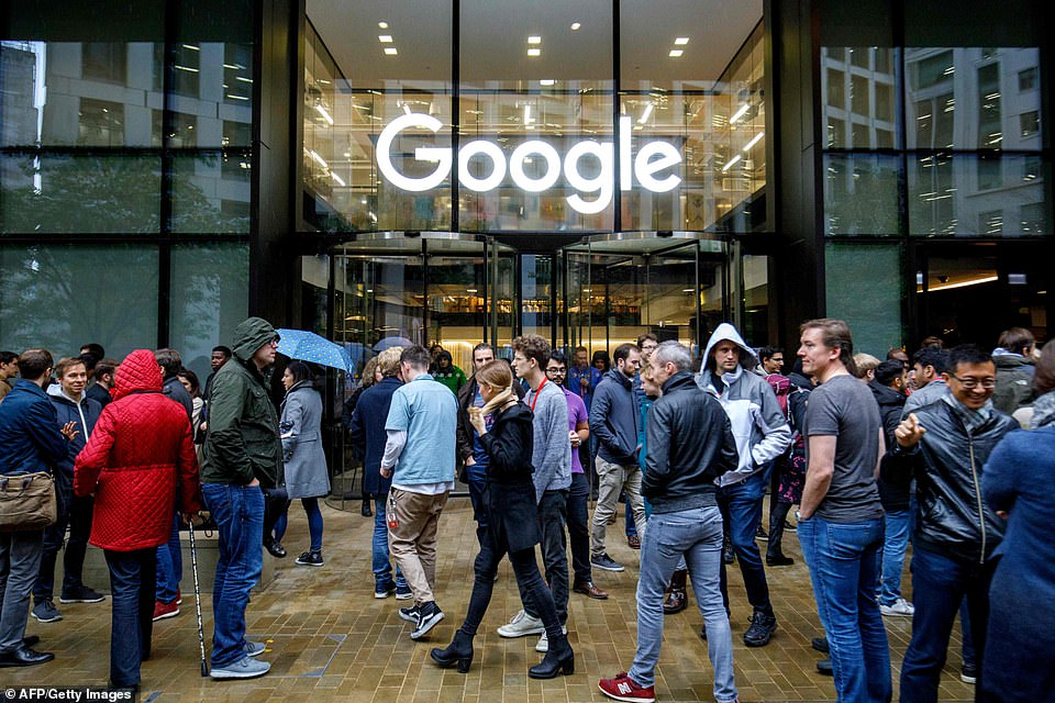 London Google employees walk about outside of the office, in the midst of the walkout to protest company culture