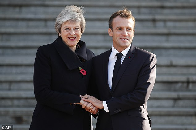 Theresa May has held talks with Emmanuel Macron over lunch in the French town of Albert today before attending Armistice commemorations