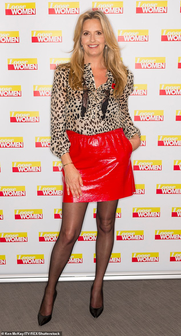 Glamorous: She added a pop of colour by teaming her blouse with a shiny red miniskirt