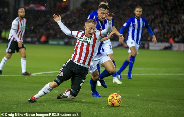 Sheffield United's Mark Duffy wins a penalty during the first half of Friday night's derby