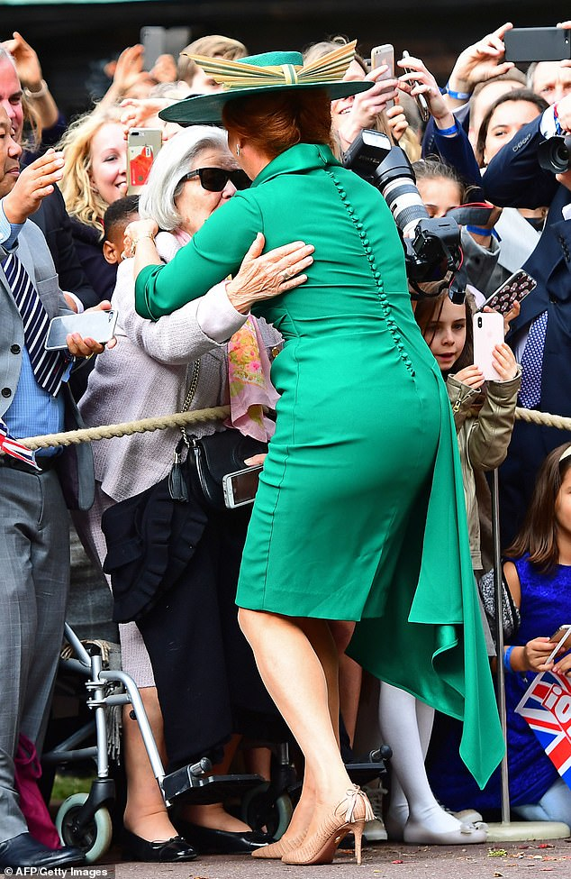 Sarah, Duchess of York hugs family friend, Jessie Huberty, as she arrives to attend the wedding of Britain's Princess Eugenie of York to Jack Brooksbank at St George's Chapel, Windsor Castle, in Windsor, on October 12, 2018