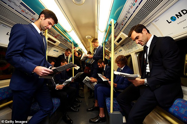 Roger Federer (right) and Novak Djokovic (left) took a trip on London's Jubilee line on Friday