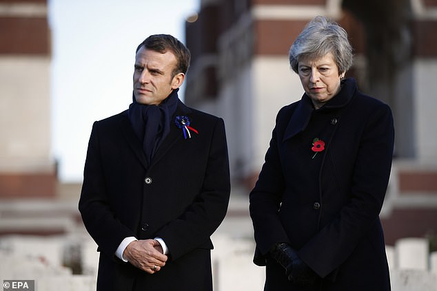 The commissioner also hit out at Theresa May (pictured at a WW1 memorial event with French President Emmanuel Macron) for her leadership when she was Home Secretary