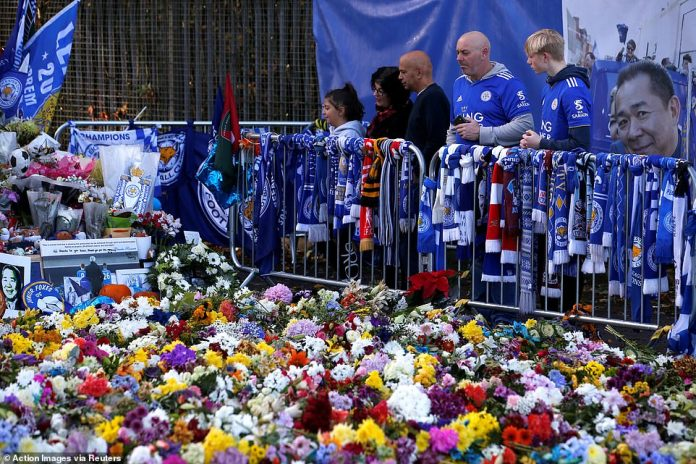Supporters shared the silence as they watched through the many colors of the floral tribute out of the King Power