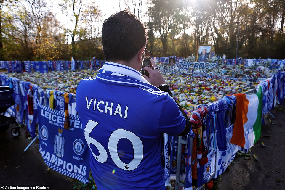 A fan stopped to take a picture while wearing a freshly printed Leicester shirt bearing the name of the deceased chairman