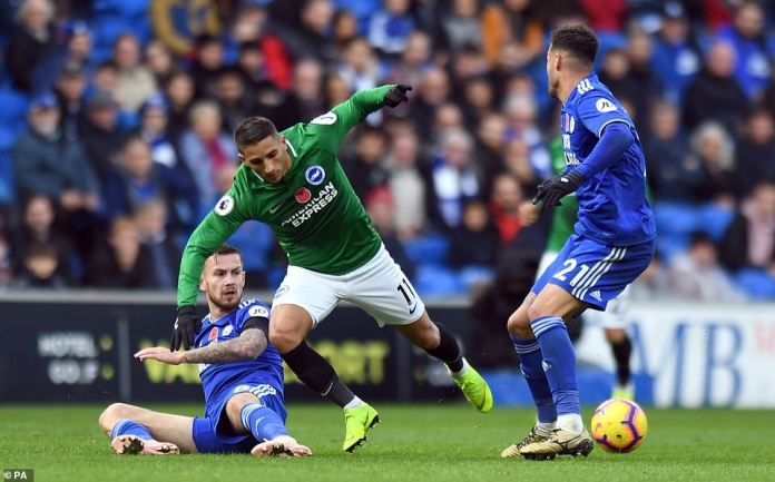 Joe Ralls (left) slips in to make a good interception to stop Anthony Knockaert and break Brighton's counterattack