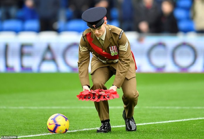 A wreath of poppies is placed in the central circle before kick-off as part of the commemorative commemorations in Cardiff