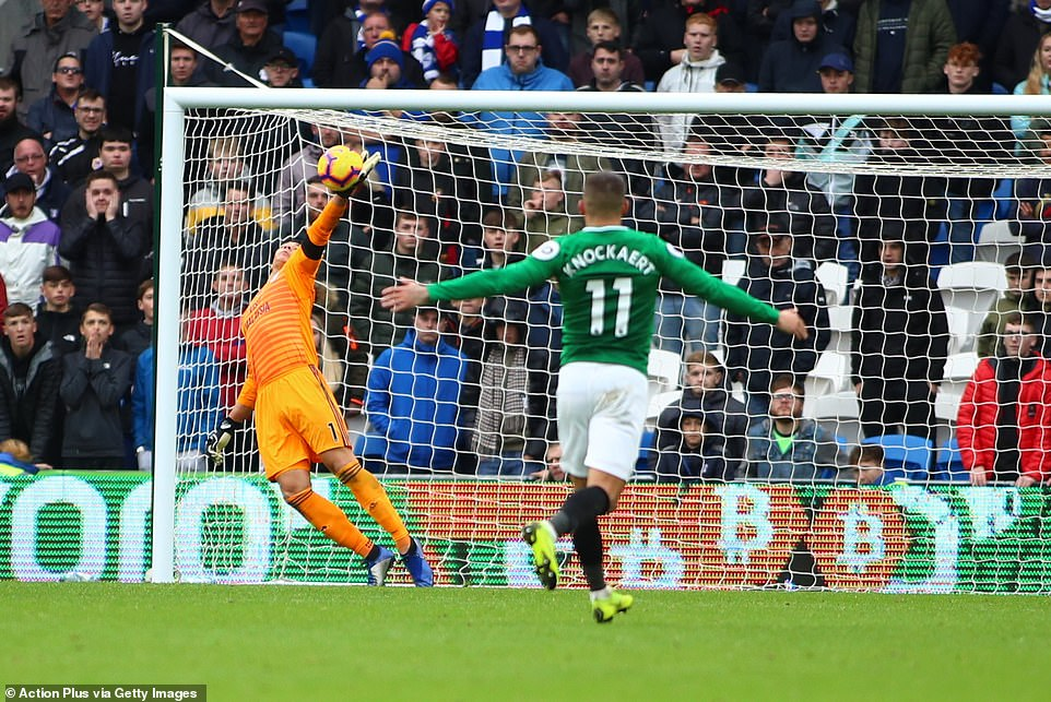 Neil Etheridge dives to his right and manages to beat a deflected effort by a Brighton player away from the goal to keep him level