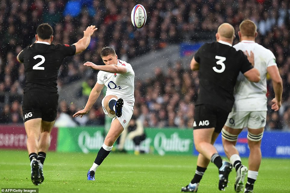 Owen Farrell (second left wing) of England is successful with his drop-goal attempt during the first half of the test game