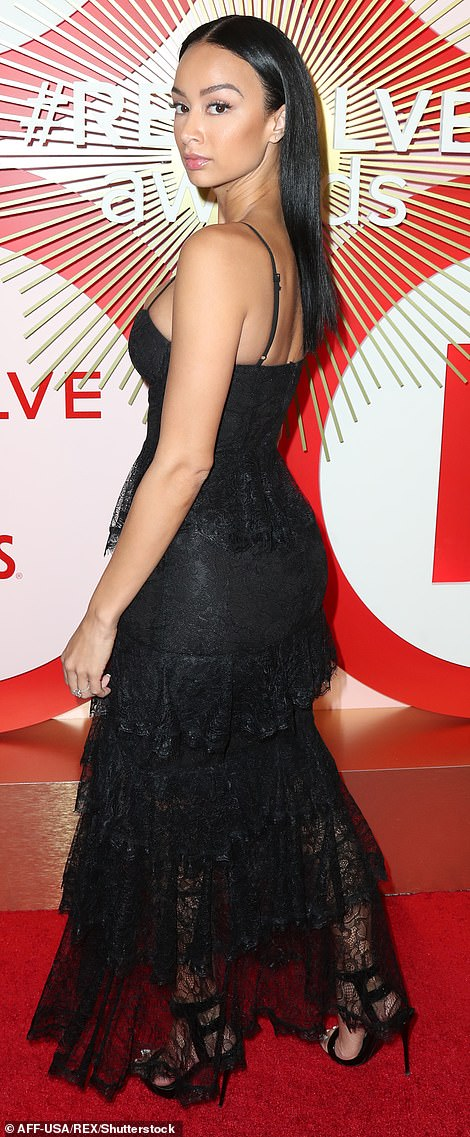 Wow: Draya Michelle, meanwhile, continued the parade of black attire at the REVOLVE awards, as she stepped out sporting a ruffled lace dress that came complete with a daring thigh-high split at its centre