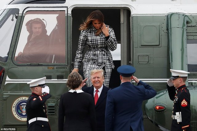 U.S. President Donald Trump and first lady Melania Trump exit the Marine One helicopter heading to Air Force One prior to departing Washington for Paris
