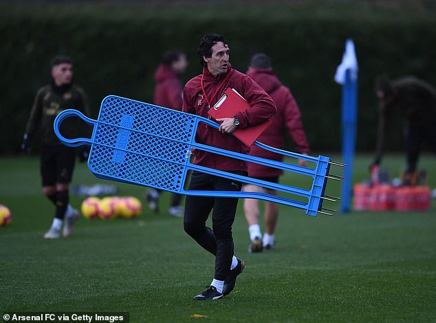 On the eve of Arsenal's Wolves game, Emery wears a clipboard and training dancer
