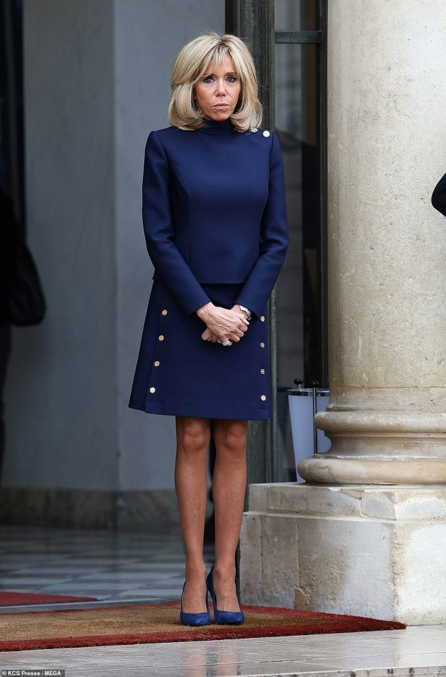 Brigitte Macron, on the other hand, chose royal blue decorated with random brass buttons, by Louis Vuitton for £1,590