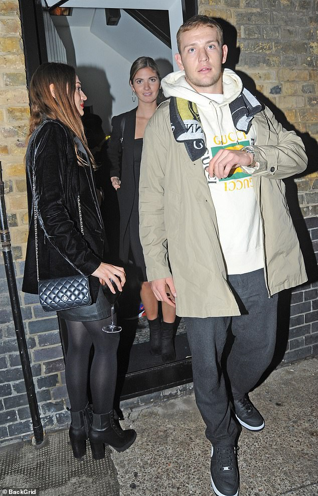 Night out: The model was joined by a mystery male pal for the fun evening out