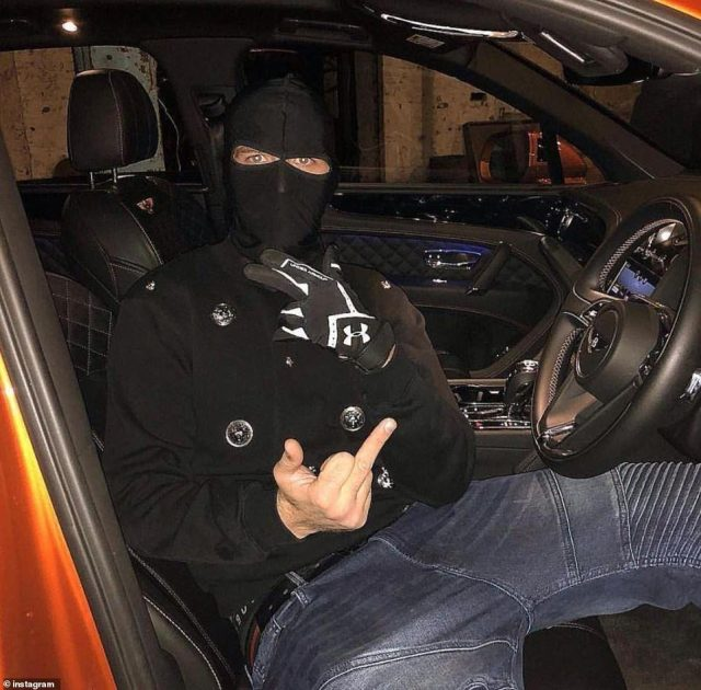 One gang member poses with his middle finger up in an orange Bentley car. The group have links with the Mafia back home in Albania, which gives them a direct supply of cocaine from South American drug cartels