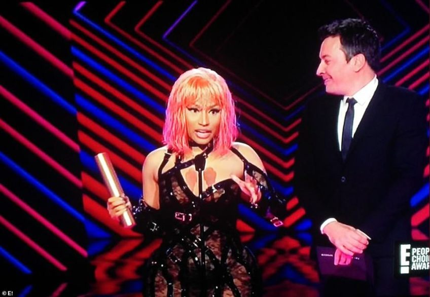 Candid:During Nicki Minaj's acceptance speech for Album Of The Year for Queen, the rapper thanked God, her fans and voters; she also jokingly gave a shout out to 'Kim Kardashian's a** in that dress'
