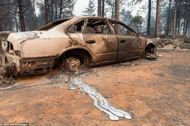 A car sits next to a trail of metal which was melted by the heat of the fire before solidifying again as the blaze moved away