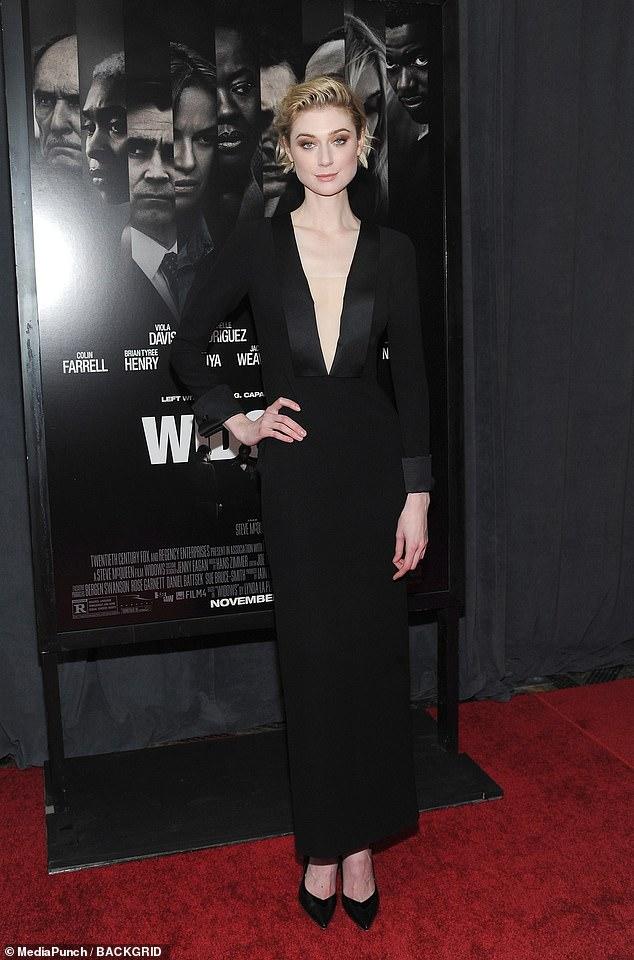 Osez franchir le pas! Elizabeth Debicki, 28 ans, a été stupéfaite dimanche soir lors de la première de Widows à New York dans une robe noire très élégante