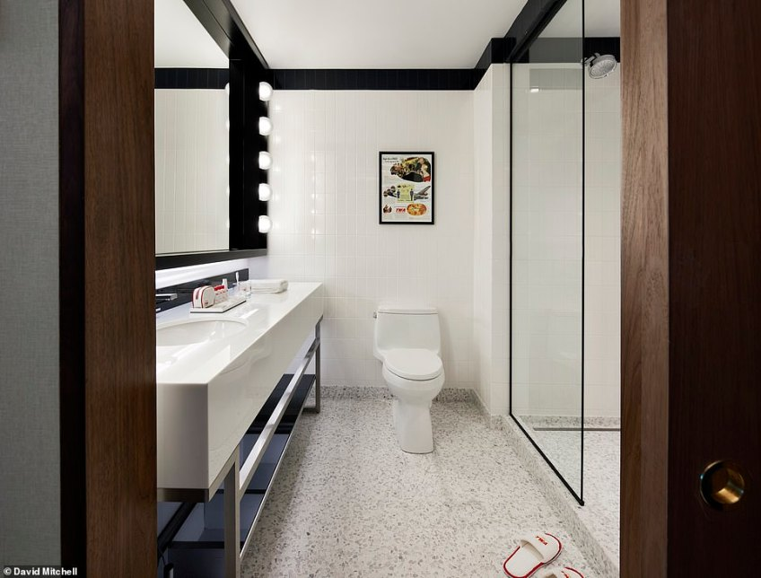 In the bathrooms, polished stone floors and a monochrome tiling theme completes the slick look