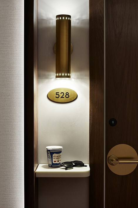 Room entryways will be signposted with brass signs and stone shelves