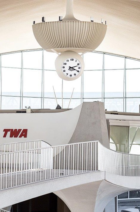 The retro TWA terminal clock remains in places as an original features