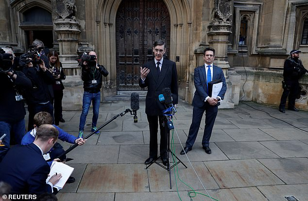 Jacob Rees-Mogg (pictured outside the Commons today) sensationally launched his bid to remove Theresa May today threatening her position in the Commons before holding a press conference naming possible successors