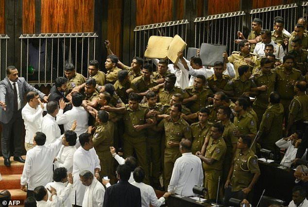 President Karu Jayasuriya was able to take his place only after joining the assembly, surrounded by police officers and parliamentary staff