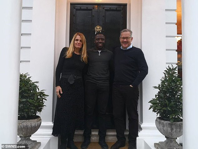 No one could be more thrilled than Elizabeth and Quintin Price, left and right, who maintain that they only did what anyone else in their position would do for Reggie, centre