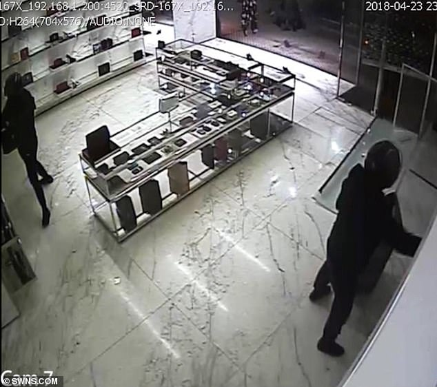 ee9b012e575 They stripped the Yves Saint Laurent store of about 85,000 pounds of  handbags