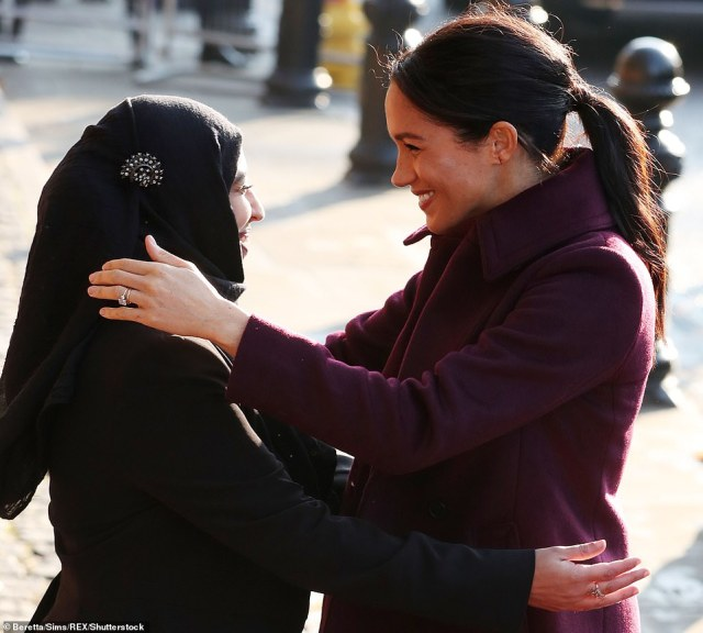 Meghan hugs Zaheera Sufyaan, who is part of the Hubb Community Kitchen in West London as she visits the centre today
