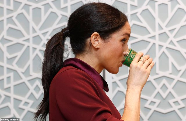 The Duchess of Sussex has a drink as she visits the Hubb Community Kitchen in West Loidon this morning