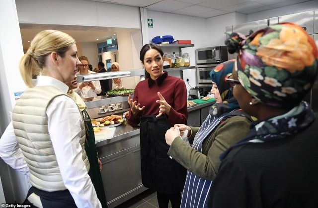Meghan helped prepare the food as she introduced chef Clare Smyth (far left), a friend of hers, to volunteers in the kitchen