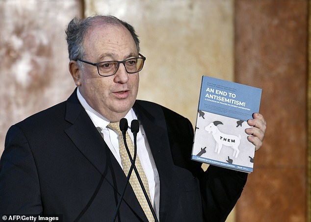 Ariel Muzicant, Vice-President of the European Jewish Congress, and co-author of the new document holds it up, showing the title 'An End to Antisemitism! A Catalogue of Policies to Combat Antisemitism'