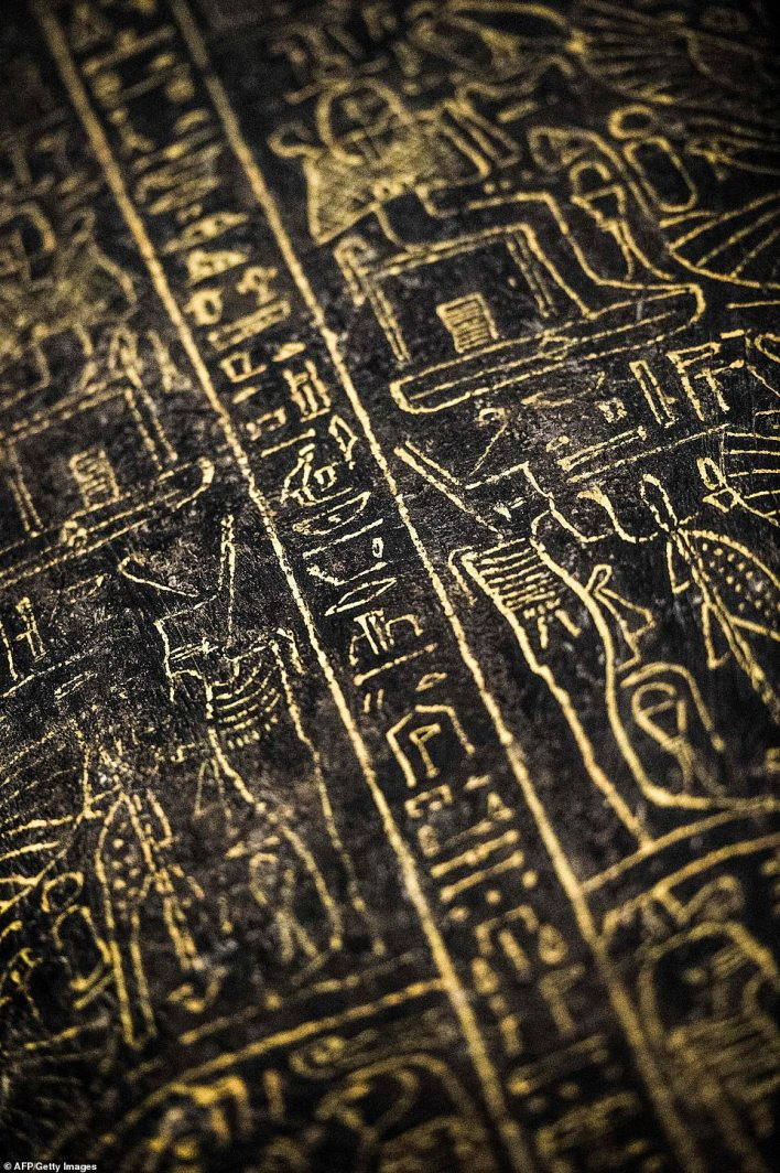 A close-up view of hieroglyphics carved on a black wooden sarcophagus inlaid with gilded sheets discovered by an Egyptian archaelogical mission at Al-Assasif necropolis on the west bank of the Nile