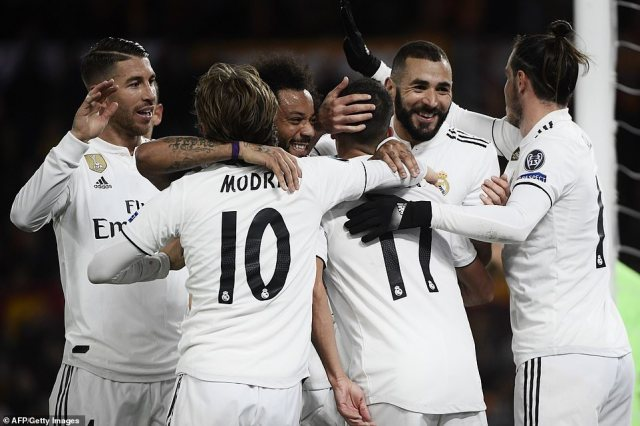 Real Madrid sealed top spot in Champions League Group G on Tuesday night by beating Roma at the Stadio Olimpico
