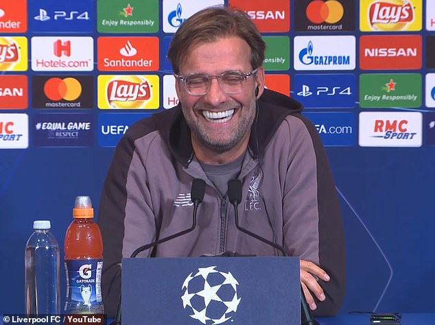 The German laughed along with other journalists in the room during the press conference