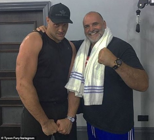 Fury poses with his father John, 53, who is now on his own weight-loss mission at Hatton's gym