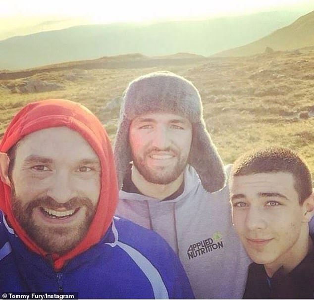 Tommy grew up with Tyson and their cousin (and fellow heavyweight) Hughie Fury, centre