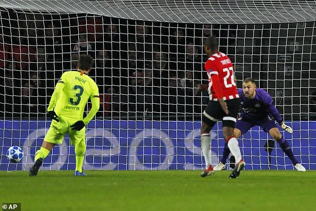 Barcelona defender Gerard Pique, left, slots the ball into the corner for second goal