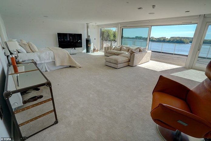 There is a large master bedroom on the second floor, also with floor to ceiling windows
