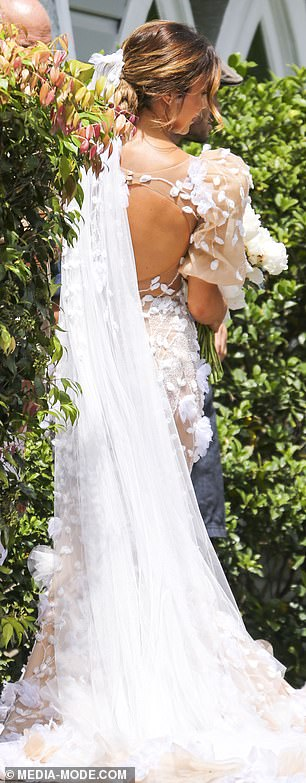 She's a modern bride! The former lawyer opted for a backless design