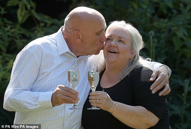 Mr Higgins, 67, pictured with his wife, Lesley, 57, said he still buys a few lotto tickets a week