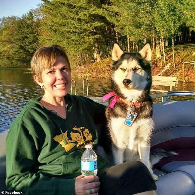 "The former grant writer is now retired and on the board of directors of the Wisconsin Ovarian Cancer Alliance. He hopes to write a book about Sierra to show that animals are ""smart enough"". Mrs. Herfel, originally from California, is depicted with the pet on May 23, 2015"