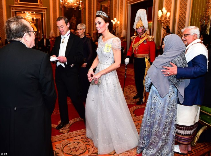 The Duchess of Cambridge put on a dazzling display in the Lover's Knot tiara as she arrived at the venue, dressed in a sparkling white gown with metallic silver detailing on the shoulders wearing the Royal Family Order of Queen Elizabeth II