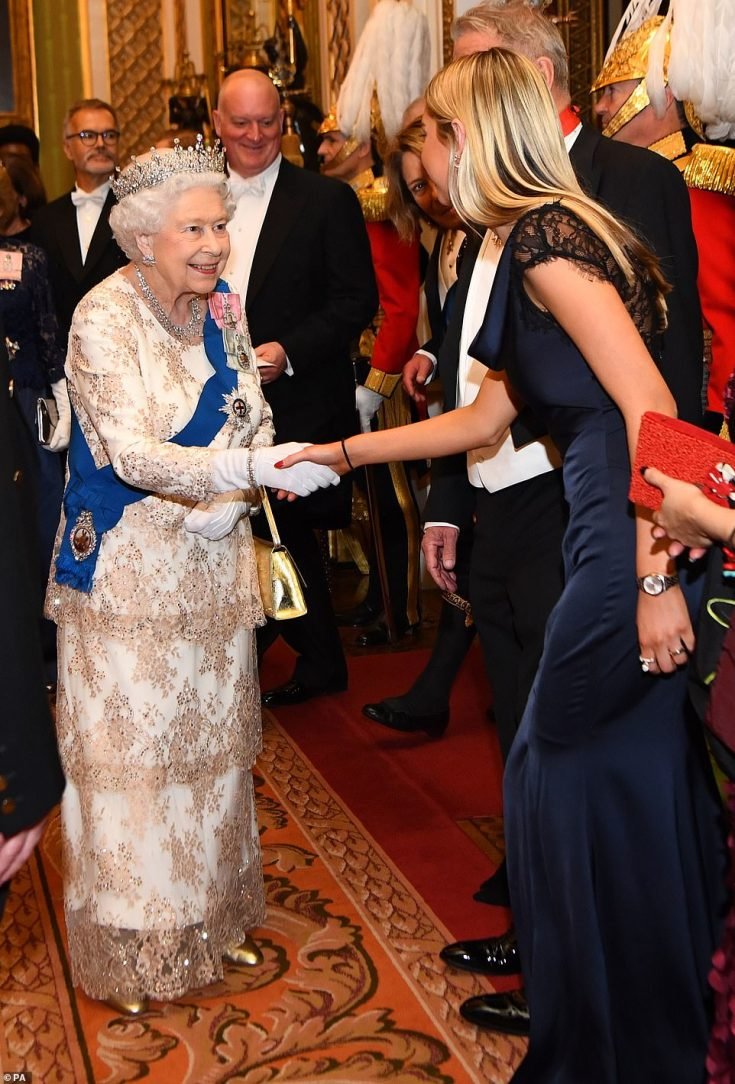 The Queen, 92, looked regal in a white gown with delicate tiered lace overlay as she greeted the ambassador of Norway at the evening reception at Buckingham Palace. The monarch paired the dress with a metallic gold handbag and heels