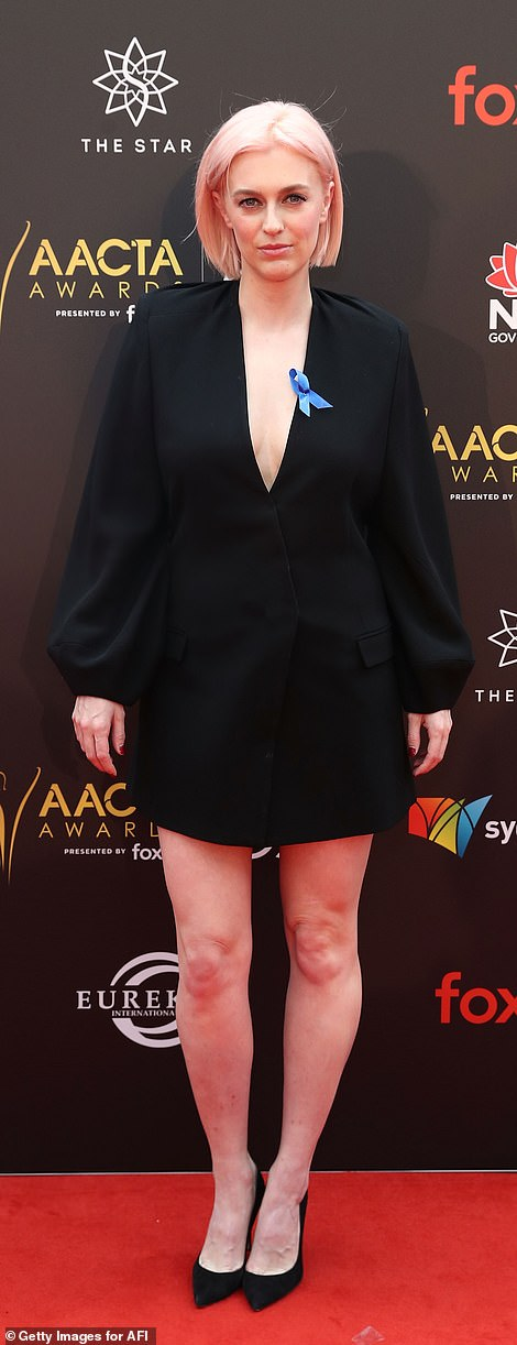 How low can you go!Actress Grace Otto, 31, wore a plunging black blazer dress with puffy sleeves and pointed-toe heels