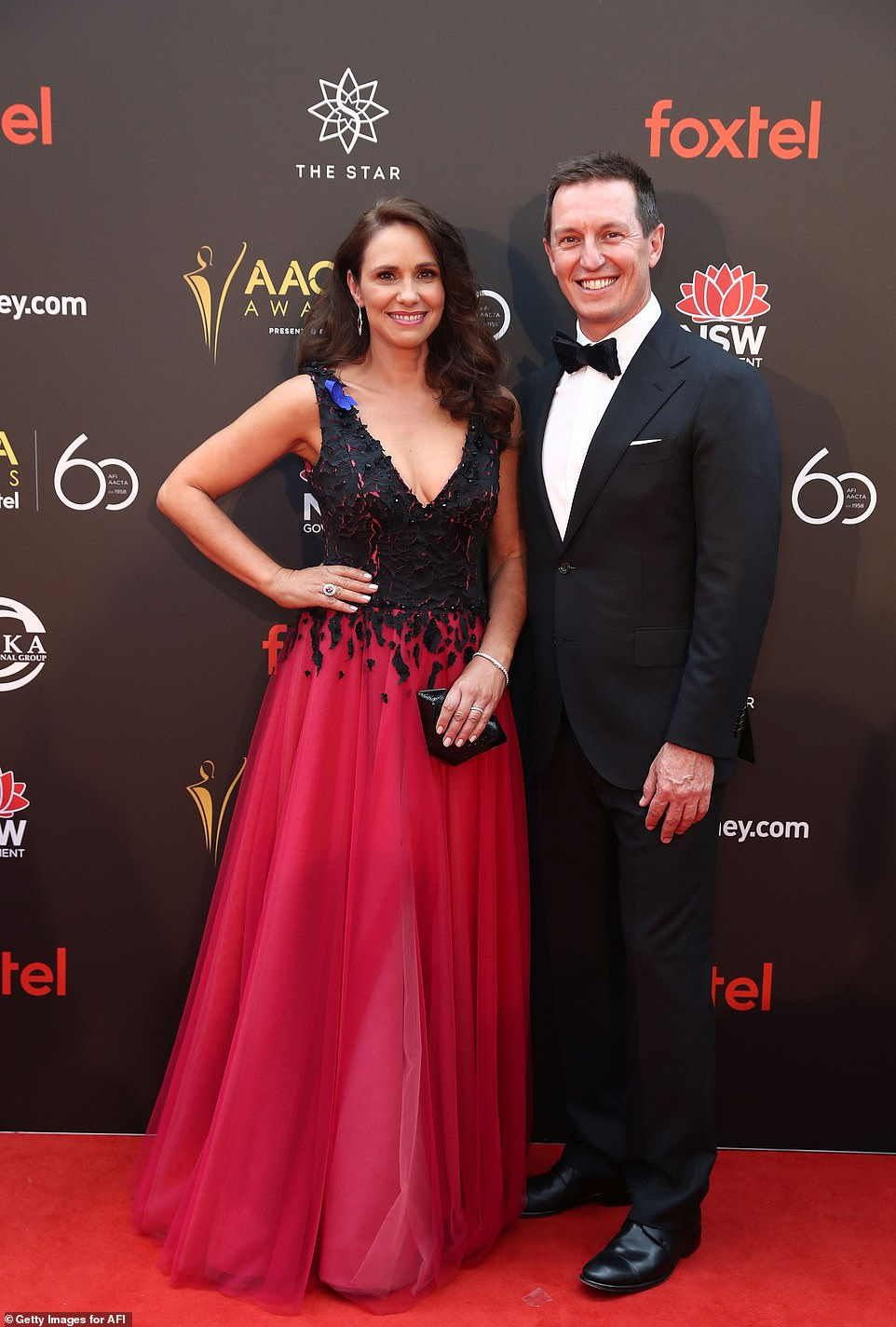 Date night! Rove McManus' wife Tasma Walton looked elegant in a pink and black princess-style gown while posing alongside her hubby